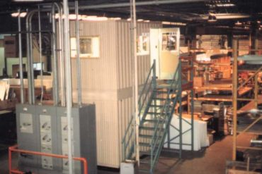 stackable two-story & crane liftable buildings in a warehouse